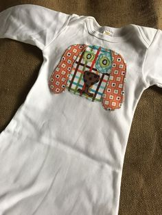 A personal favorite from my Etsy shop https://www.etsy.com/listing/497015856/dog-applique-one-piece-baby
