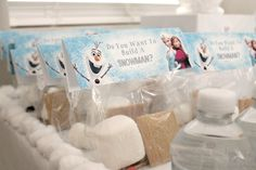 Easily create a fun DIY snowman kit for your kids to keep them busy during winter break. It's also a great party favor for those Frozen inspired parties!