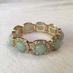 HOST PICK NWOT mint, gold rhinestone bracelet 1/2/16 host pick! New without tags. Lovely combo of mint colored stones, rhinestones and gold tone. This stretch bracelet sparkles and dazzles. Jewelry Bracelets