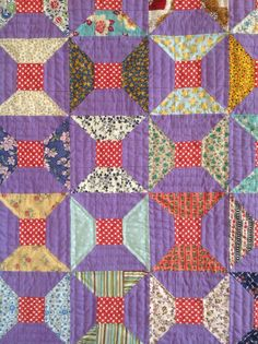 My hand-quilted bow ties quilt.