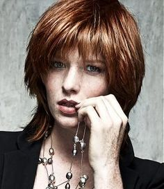 A Medium Red straight layered defined-fringe choppy womens haircut hairstyle by Jean Marc Maniatis