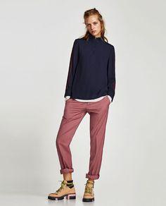 изображение 1 из TOP WITH ZIP AND SIDE STRIPES от Zara