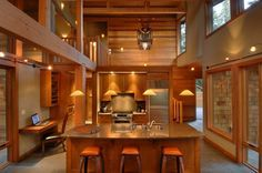 Perfect the warm atmosphere of this kitchen using cedar paneling and trim boards.  from Western Red Cedar Lumber Association