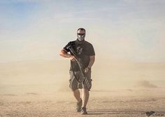 S A N D M A N  Via @ktmoney  Without deviation from the norm progress is not possible. @realdirtyharry captured this awesome photo of me in the desert! #rebelwarlord #rebelasfuck #realdirtyharry #2a #gunporn #gunsdaily #sickguns #shotgun #traphouse #lasvegas #desert #igmilitia #lionmk #photoshot #notfuckingaroundcrew #ghostridethewhip #benelli #luminox #slingerlife #slingersclub