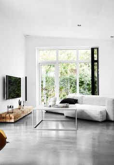 Spacious And Grey Living Room In Nordic Style With Concrete Flooring And  Homebuilt Solutions.