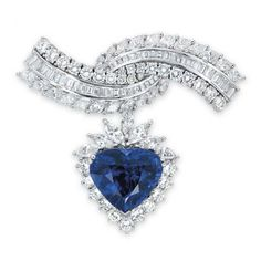 A SAPPHIRE AND DIAMOND BROOCH. The detachable pendant set to the centre with a heart-shaped sapphire, within a brilliant and marquise-cut diamond surround, suspended from the overlapping arched brooch set with vari-cut diamonds, mounted in white gold, 5.6 cm long