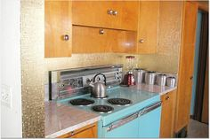 Photos like this keep my hopes up. I WILL find a time capsule house. Check out the GOLD WALLPAPER and original cabinets!!! (Stoves are easy - it's the rest of it that get all fucked up by idiots)