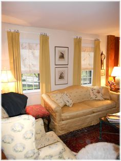 Classic pinch pleated drapes in a beautiful velvet and custom made roman shades in a beautiful embroidered silk print.