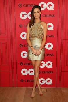 Australian model Nicole Trunfio wore a bold, brocade gold minidress that showed off her gorgeous, glowing tan.