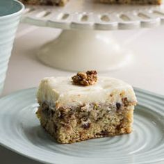 Banana Cake studded with Chocolate Chips and topped with Cream Cheese Frosting and Sugared Walnuts.