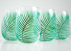 """Green Ferns Stemless Wine Glasses - Set of 4 Hand Painted Fern Glasses. ♥ A bit of nature in your home. ♥ These stemless wine glasses are hand painted in my delicate Fern design. On each glass a delicate fern spirals and curves around the glass. :: This is a listing for 4 stemless wine glasses ::The glasses are 4.5"""" tall :: They are perfect for water, wine, iced tea and juice :: Hand-painted with non-toxic glass paints :: Completely original and one-of-a-kind :: Dishwasher safe on the top..."""