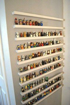 Smart Tricks To Keep Your Kids Organized DIsuch a cute idea for a kids playroom with characters to display when not playing with them.DIsuch a cute idea for a kids playroom with characters to display when not playing with them. Lego Display, Display Ideas, Lego Minifigure Display, Lego Minifigs, Lego Duplo, Deco Lego, Toy Rooms, Kids Rooms, Boys Room Ideas