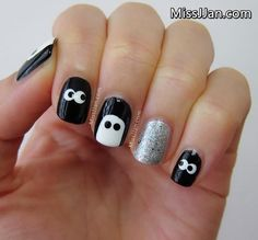 MissJJan's spooky-eye nail art may look difficult, but you'll really need only a few shades of polish and two nail-dotting tools in different sizes. Use the dotting tools to create the eyes and to round off the edges on the ghost-shaped nail art. Add a metallic accent nail to keep this Halloween nail art a little bit glam.