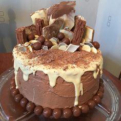 [Homemade] A chocolate cake made for my partner's birthday - includes Cadbury Flakes, Kinder Eggs, Malteasers, Homemade Chocolate Bark and White Chocolate Buttons! Homemade Chocolate Bark, White Chocolate, Chocolate Cake, Cadbury Flake, Chocolate Buttons, Flakes, How To Make Cake, Cake Designs, Cake Decorating
