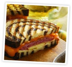 Smoked Cheddar and Ham Panini | DCI Cheese Company - this is delicious! I used rye bread, leftover Thanksgiving ham and smoked gouda...definitely a new favorite!! The onions in the maple syrup - TO DIE FOR!! The apple added a nice crisp too!