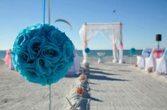 Florida beach wedding style with turquoise and coral accents