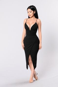 - Available in Black - Deep V Neckline - Side Slit - Mini Dress - Made in USA - 96% Polyester 4% Spandex