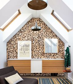 Cover an accent wall with a mosaic of wood slices to give the illusion of stacked firewood. It's an innovative way to make your home look warmer and more inviting.