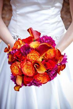 vibrant bridal bouquet of deep reds, oranges  purples - a ...