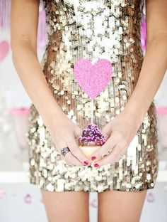 cupcake with pink heart topper and sequin gold dress