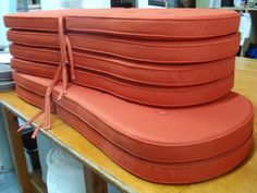 A set of patio chair cushions in Atlanta Dark Orange with piping, buttons and ties. #garden seating #outdoor cushions