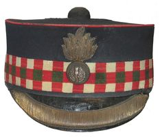 In the 1880 General Order No. 72 the forage cap with the large, rectangular, flat peak was replaced by the cap with the steeply sloping peak. This is sometimes referred to as the 'Station Master's' style.    Below is one to the Leinster regiment.