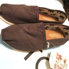 TOMS classics in brown BRAND NEW TOMS in chocolate never worn with tags and original toms canvas bag TOMS Shoes Flats & Loafers