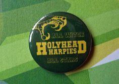 Show your support for the Holyhead Harpies with this 1 inch (2.5cm) pin badge. The all witch all stars have flown more than their fair share of legendary Quidditch players, including household names such as Glynnis Griffiths, Gwenog Jones, and Ginny Weasley. Pin this badge to your robes to prove that you bleed dark green and gold!    This badge is part of a thirteen part set for all of the British and Irish Quidditch teams.