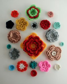 Crochet Flowers and leaves pattern by gabyv. You can find them under her notes. The flower square is the Eureka pattern by Rosehip here http://rosehip.typepad.com/rose_hip_blog/2008/11/pattern.html