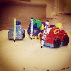 Drawing with cars, fun mark making activity for toddlers and preschoolers.