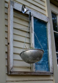 Vintage window with hanging plant $150