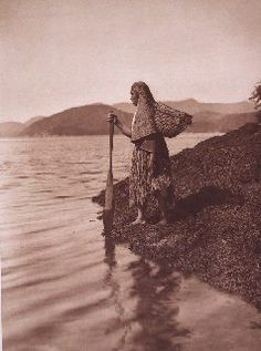 """The Seaweed Gatherer (1915)  """"Seaweed of the genus Porphyra is a favorite food among all the tribes of the North Pacific coast. The green, membranous fronds are gathered in the spring from tidal rocks and are pressed into flat cakes and dried."""" - Edward Curtis"""