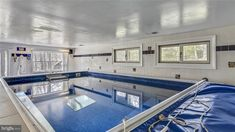 A basement Endless Pool for fun and fitness in Annandale, VA Endless Pools, Family Room, Home And Family, Toll House, Deck Stairs, Fee Simple, Built In Bookcase, Modular Design, Fenced In Yard