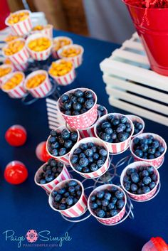 "Fruit cups in cupcake holder....I love how they're displayed on a cupcake tree stand!  What a cute way to serve ""finger"" fruit pieces!  :)"