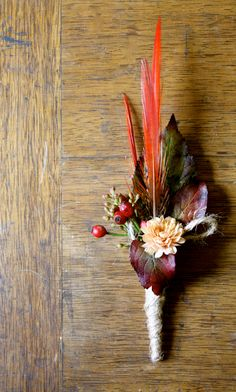 Autumn leaves & feather buttonhole.
