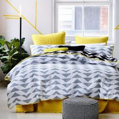 Featuring a unique and contemporary geometric triangle pattern and finished with a vibrant, yellow trim the Xavier quilt cover from Home Republic is perfect for a modern decor. Extremely versatile, this cover is perfect for use with a quilt in the cooler months or on its own in summer for a lightweight alternative. For those who love an extra pop of colour, the bright yellow quilted European pillowcases will complete the look perfectly.