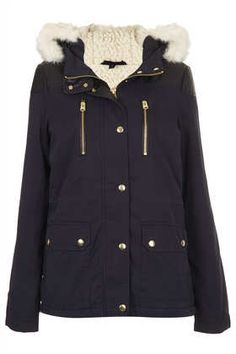 FUR TRIM BORG LINED SHORT PARKA  Price:£78.00 Colour:NAVY BLUE  This exact jacket from Top Shop - no idea about the Canadian price though :(