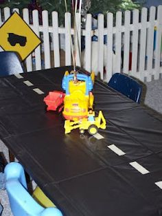 An easy way to decorate a table...black table cloth...or trash bags...with silver duck tape. Add trucks. Cute for a boy baby shower or bday party. truck birthday, boy baby showers, truck party, tablecloth, birthday parties, construction party, road, tabl cloth, masking tape