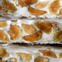 Chewy Almond Nougat Recipe | Recipe4Living  During Christmas it was a tradition my grandmother and my mom would buy this nougat bar...#Puerto Rican Christmas Tradition