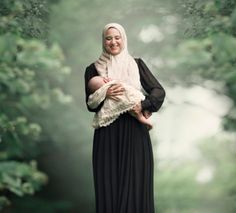 """Photographer Ivette Ivens also works to break down the stigma of women and breasts with beautiful photos of real mothers celebrating breastfeeding. She writes, """"Breastfeeding can be messy, uncomfortable, and even painful at times, but the mother's inner consciousness tells another story.""""  Below is a series of images from her book, Breastfeeding Goddesses."""