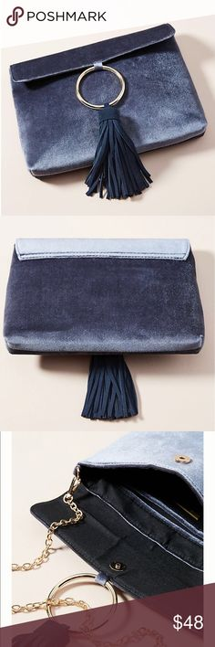New! Anthropologie Slate Velvet Clutch New! Anthropologie Slate Velvet Clutch • Gorgeous slate Gray/Blue Velvet Clutch • Brand New with tags • Gold circle with tassel • Removable chain strap • Magnetic snap closure • Dustbag included • Nice medium/large size • Dimensions + Details in Pictures • Customer 5 🌟 Favorite Anthropologie Bags Clutches & Wristlets