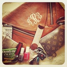 The monogramed clutch is so classy.