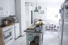 I love this white kitchen