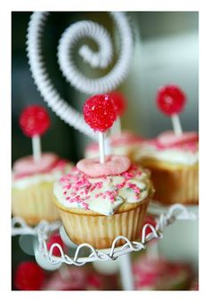 Fun cupcake topper... take a dum dum sucker dip in water then sprinkles and place on top of cupcake!