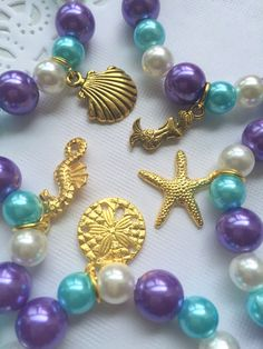 Mermaid, starfish bracelet set, GOLD plated, mixed charm set. SET of 10 ( 2 of each). Kids birthday party, birthday favor.  ******************  Party planning is already so stressful. Leave the favors up to us!  This listing is for (10) bracelets, please let us know if you need more or less and we can make you a custom listing.  DETAILS and MEASUREMENTS: Beads vary in sizes from 6mm-10mm. The length of a bracelet is 6.5 (we can make them smaller or bigger for you).  COLOUR & CHARM CHOICES...