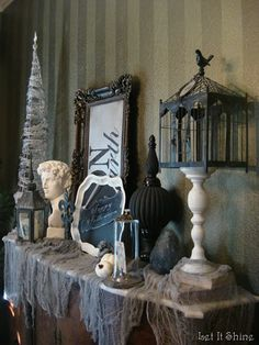all black and white!! birdcage on a candlestick, cloche with skeleton picture, gargoyle etc.  Love the ideas here