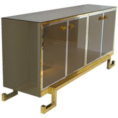 Smoked Mirror brass & chrome sideboard 1970's  | From a unique collection of antique and modern buffets at https://www.1stdibs.com/furniture/storage-case-pieces/buffets/