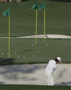 Kevin Na hits out of a sand trap during a practice round for the Masters golf tournament Monday, April 2, 2012, in Augusta, Ga. http://www.Augusta.com