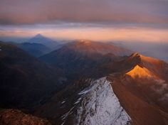 Mount Rocciamelone, Italy National Geographic photo of the day by Roberto Bertero 5/15/11.  Sunset view from the summit of Mount Rocciamelone (3,538 meters/11,603 feet). On the left you can easily see the huge shadow of the mountain's conical shape.