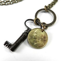 Awesome long necklace made with a genuine antique skeleton key and an authentic brass travel token from San Francisco, California. An elegant and timeless look. MEASUREMENTS & MATERIALS: * Brass chain
